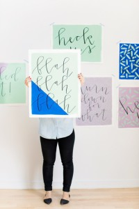 holding-large-scale-wall-art-colorful-mint-green-and-cobalt-blue